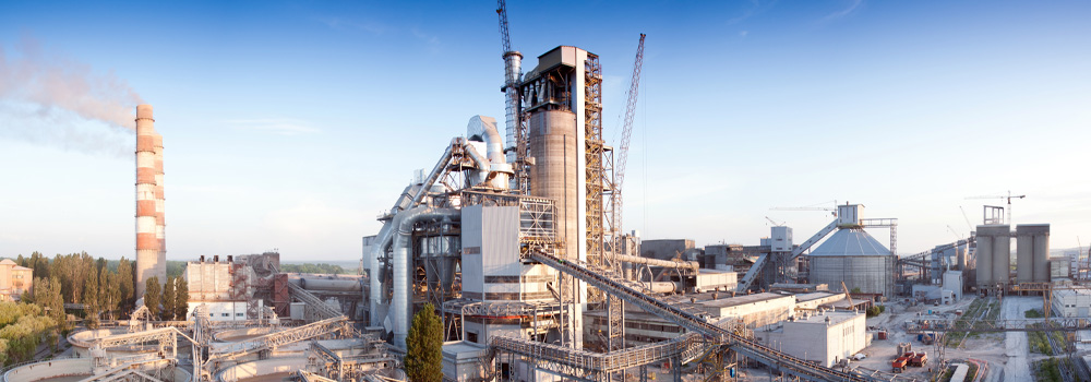 outside shot of a cement factory with blue sky